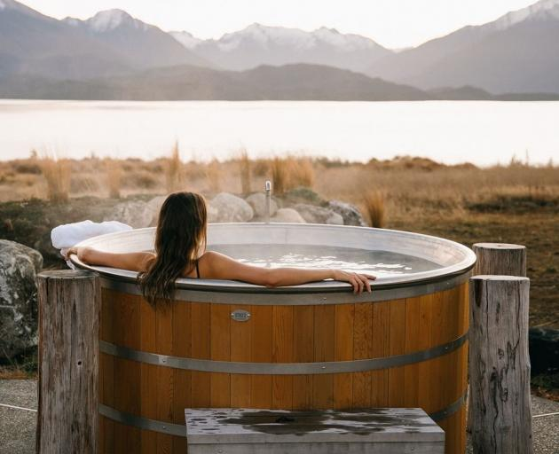 A soak in a hot tub at  Fiordland Lodge helps recharge your  batteries in time for your next day...