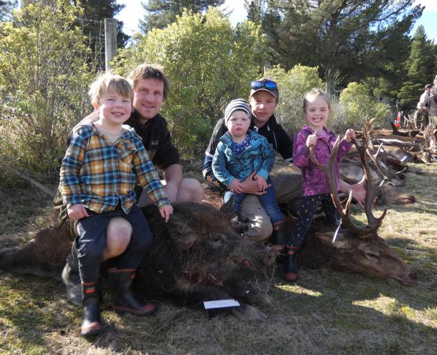 Clyde hunters (from left) Walter Horrell (4), dad Jarod Horrell with a 79.2kg boar, Hunter...