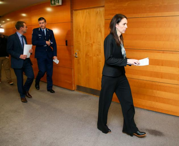 Prime Minister Jacinda Ardern arrives at a press conference at Parliament today following last...
