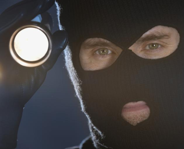 The alleged burglar was spotted shining a torch at a Leith St property at 4am. Photo: Getty...