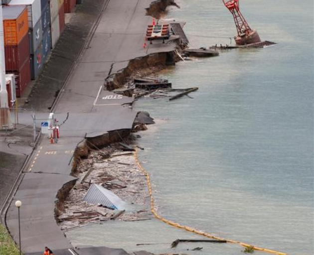 CentrePort staff inspect the damage to their reclaimed container wharf as a result of the...