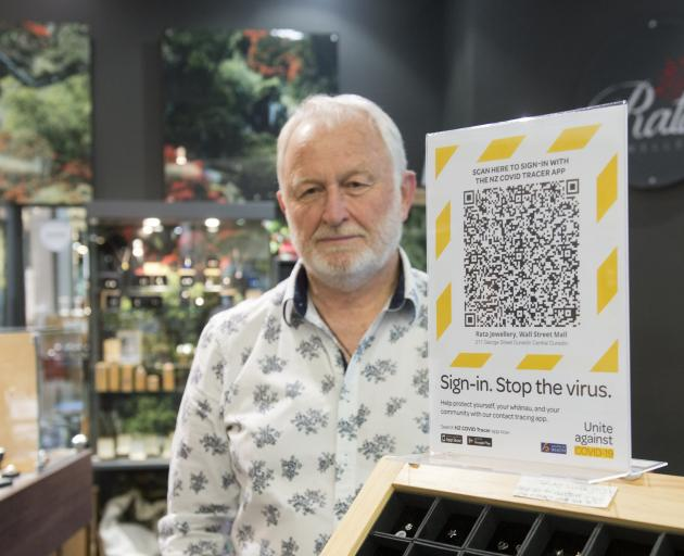 Rata owner Keith Clifford's shop in Dunedin displays the QR code for a tracing app. Photo: Gerard...