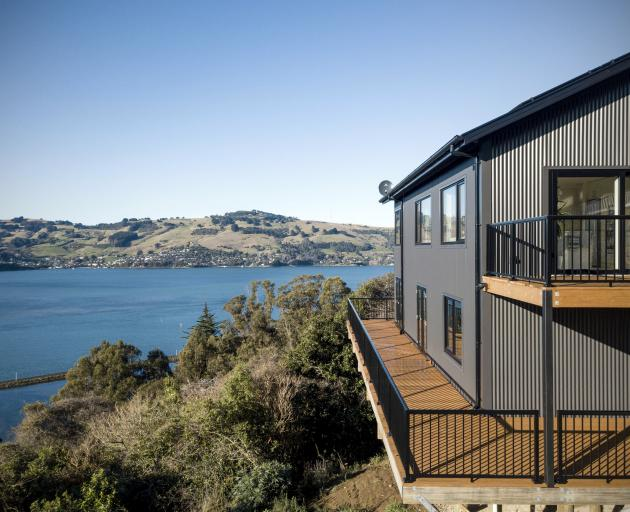Located on a steep site overlooking Otago Harbour, this certified passive house is home to a...