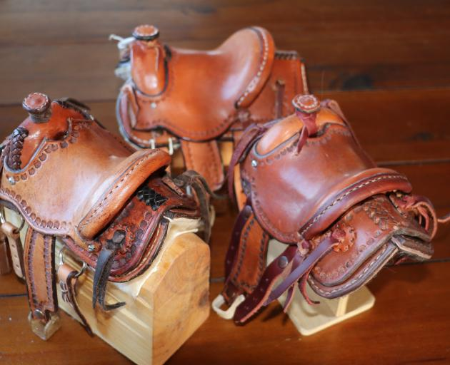 Saddle-shaped pieces of wood covered in rawhide and then varnished are the foundations for the...