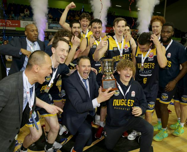 The Otago Nuggets celebrate with the NBL trophy after beating the Manawatu Jets in Saturday's...