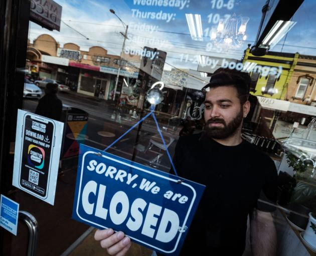 Mas Azemi has been forced to close his barber shop in the Melbourne suburb of Brunswick. Photo:...