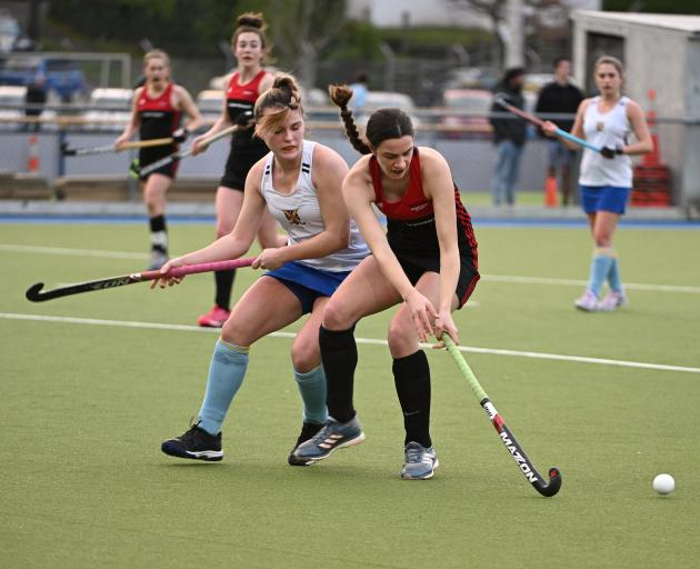 Momona's Angelique Peyroux (right) looks to control the ball as University's Lucy Griffith chases...