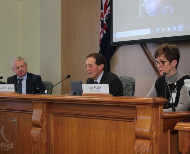 Independent governance expert Bruce Robertson (left), Mayor Sir Tim Shadbolt and chief executive...