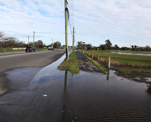 Pages Rd flooding last month. Photo: Geoff Sloan