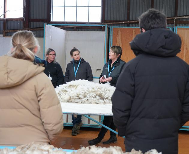 New Zealand Merino Company area manager Katrina Bishop talks fine wool, watched by PGG Wrightson ...