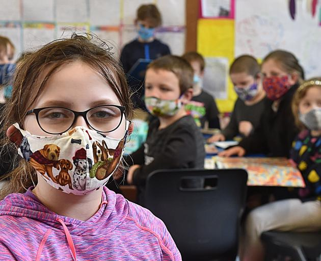 North East Valley Normal School pupil Annalise Miller (8) participates in the school's Masks on...