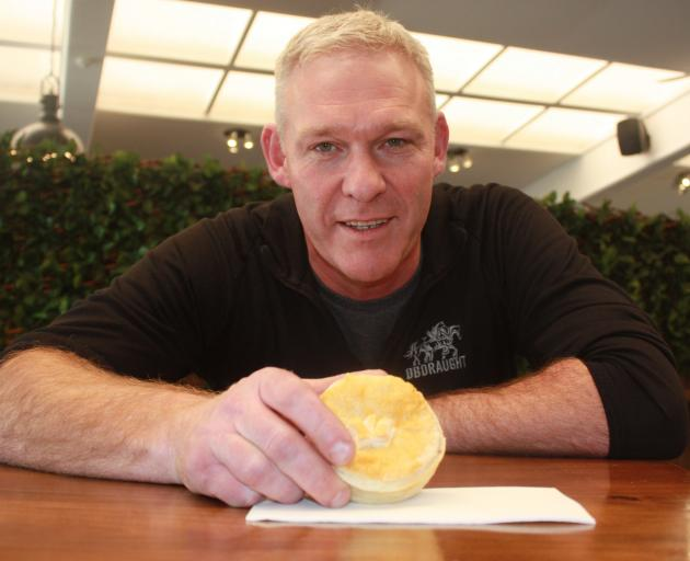 The Barn manager Adam Wilson holds one of the wallaby pies, which are proving popular with...