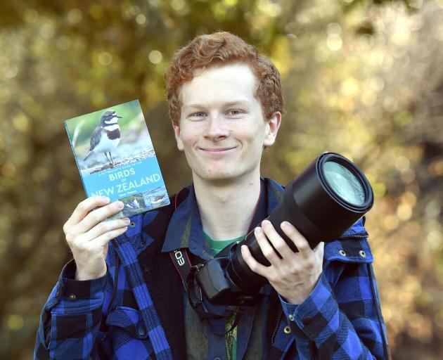 University of Otago bachelor of science student Oscar Thomas with his first book — A Naturalist's...