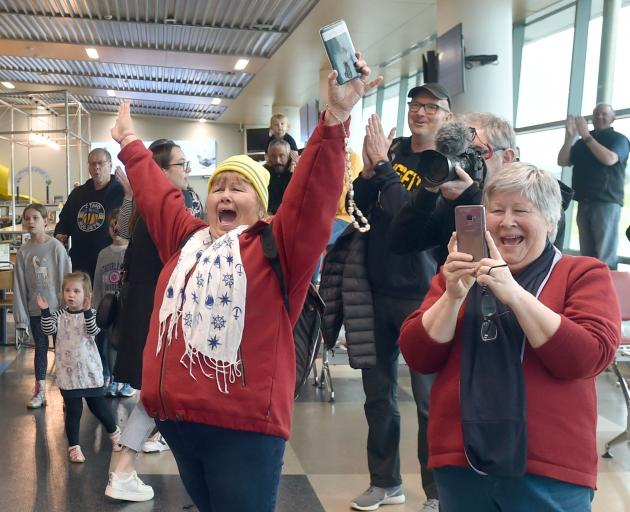 Otago Nuggets fans celebrate as the team walks into the Dunedin Airport terminal yesterday.