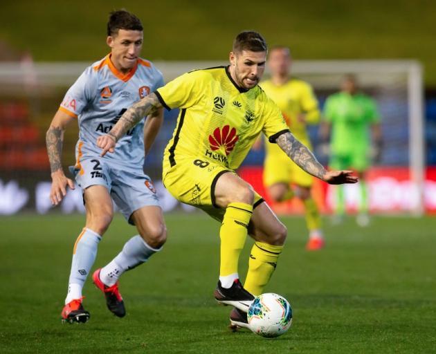 Wellington Phoenix forward Gary Hooper controls the ball during their match against the Brisbane...