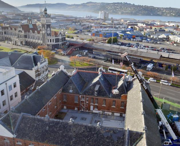 A crane lifts a pallet of roof slate tiles into the former Dunedin prison last year. PHOTO:...