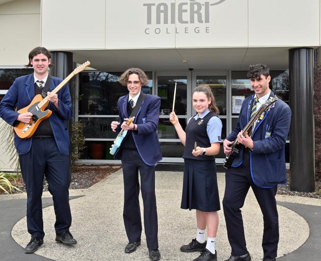 Schlappers band members (from left) Liam Boyne (17), Hamish Burgess (17), Keisha Hollands (14)...