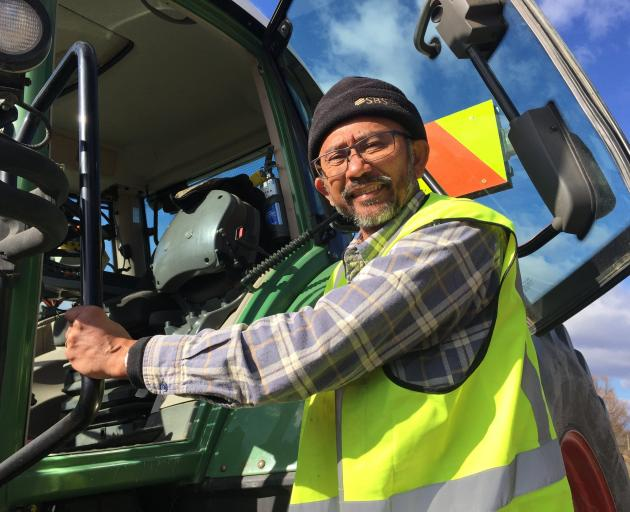 Reynold Alvins has changed careers from a tour bus driver in Queenstown to a tractor driver in...