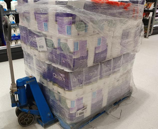 A pallet of toilet paper is pulled out to restock the shelves in Countown Frankton. Photo: Matthew Mckew