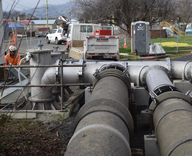 Contractors work on replacing the pumps in the Carlyle Rd pump station, in Mosgiel, last week....