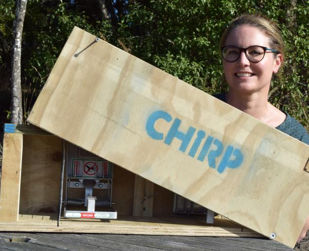 Chain Hills Restoration Project owner Rebecca Guest displays a stoat trap made by Otago...