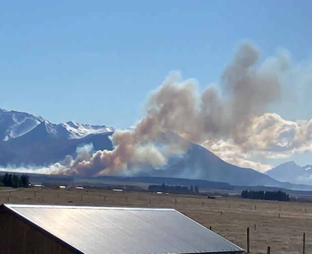 The fire was first reported in a grassy area, but strong winds caused the fire to spread to a...