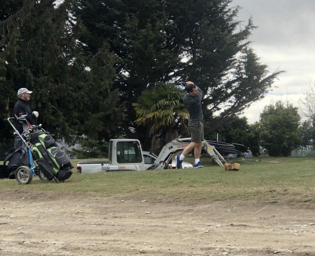 David Lee and Jamie Nesbitt play golf on the first nine at the Wanaka Golf Club, reduced to an...