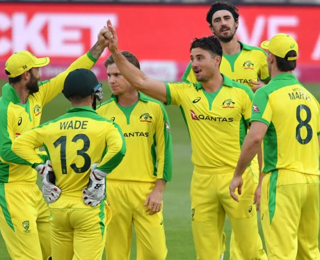 Australia celebrate a wicket during their win over England this morning. Photo: Reuters