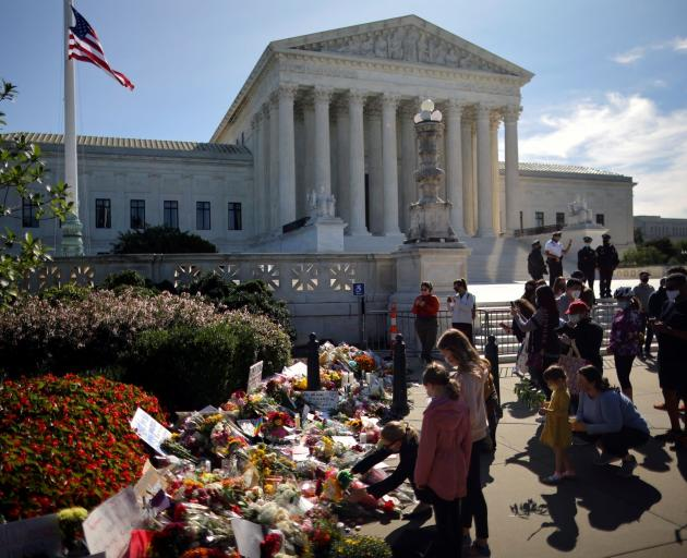 Flowers were left in front of the US Supreme Court following the death of Justice Ruth Bader...