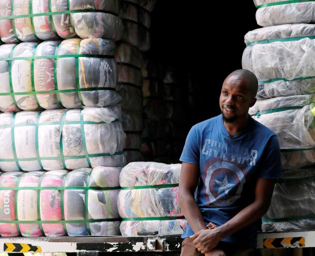 Salesman Anthony Kang'ethe with bales of imported second-hand clothes at the Gikomba market in...
