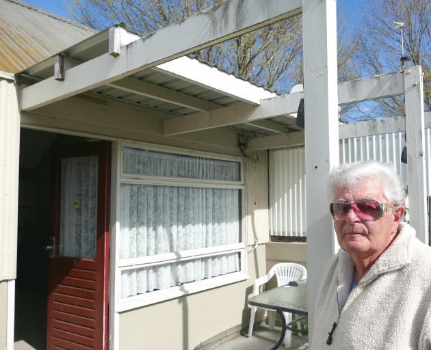 Retired security officer Gary Meek enjoys the spring sunshine outside his Naish Park community...