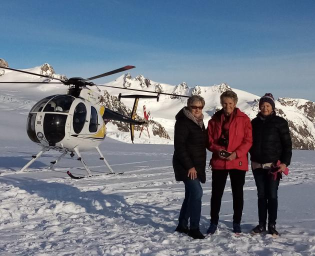 Friends (from left) Lyn Escott, Olwynne Oliver and Sue Noble-Adams took a helicopter flight to...