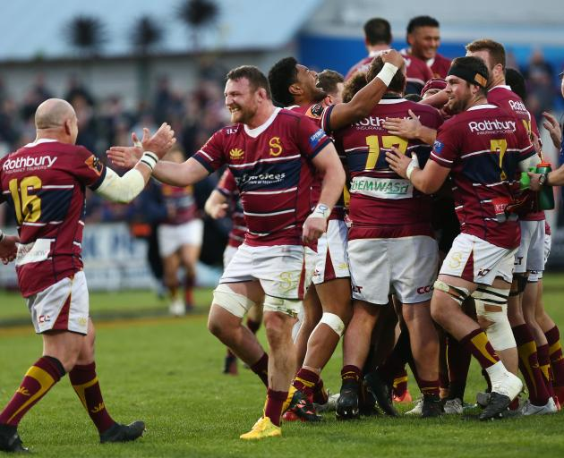 Southland players celebrate their hard-fought win over North Harbour in Invercargill Saturday....