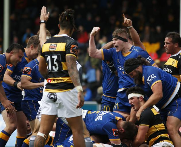 Otago players celebrate Liam Coltman's try during their victorious Shield challenge in Taranaki....