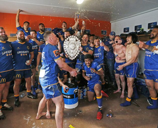 Otago players celebrate in the dressing room with the Ranfurly Shield after winning it by beating...
