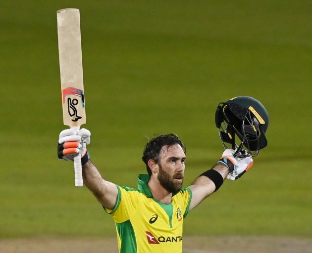Australian batsman Glenn Maxwell celebrates his century against England in this morning's ODI....