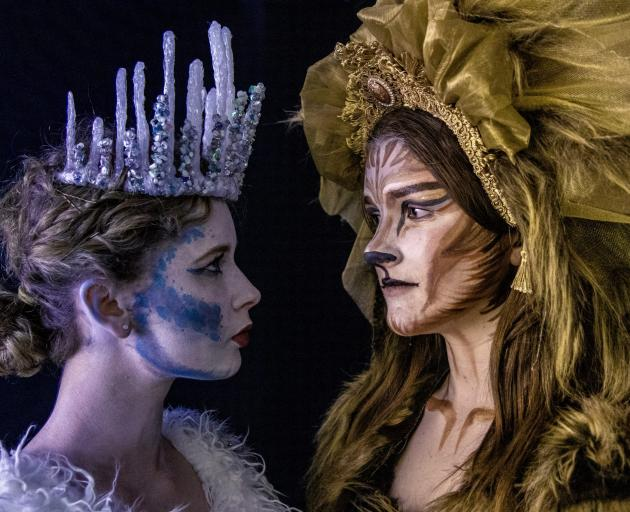 Aslan, played by Sian Hassan, right, confronts the Ice Queen, played by Michelle O'Brien, in the...