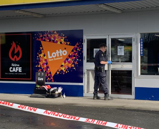 A police officer examining the scene in Invercargill today. Photo: Abbey Palmer