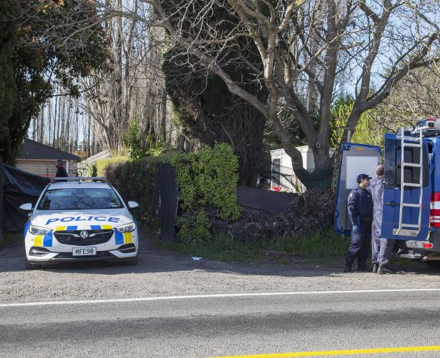 Police execute a search warrant at a property on Pound Rd in Yaldhurst. Photo: Geoff Sloan