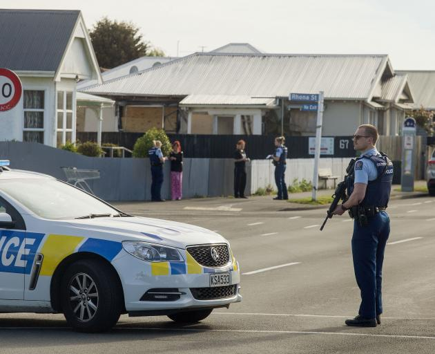 Armed police on Buckleys Rd this morning. Photo: Geoff Sloan
