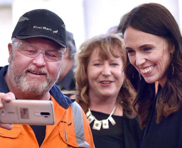 Peter Buckley, of Hillside Workshops, takes a selfie with Prime Minister Jacinda Ardern and...
