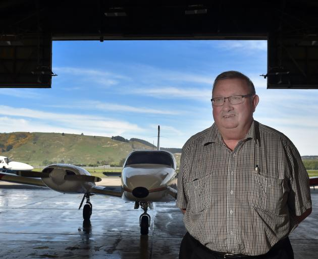 Mainland Air owner Phil Kean with one of the flight school's planes in the hanger at Dunedin...