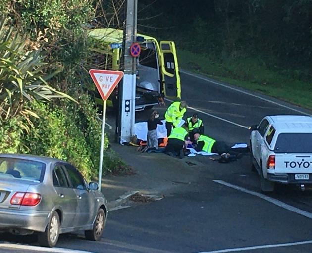 Ambulance staff at the scene in Serpentine Ave today. Photo: Christine O'Connor