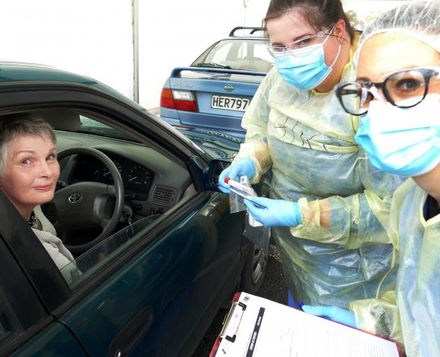 Trainee intern Alice Lumsden prepares to swab Bronwyn Scott, of Balclutha, as Balclutha drive...