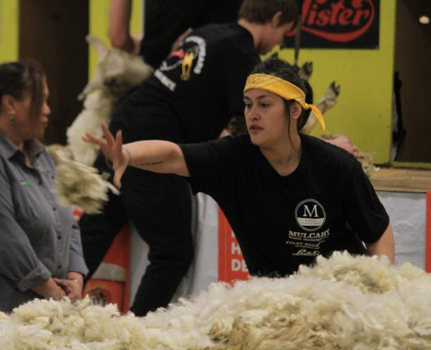 Trinity Page-Stevens, of Waimate, skirts the fleece at last year's Waimate Spring Shears. PHOTO:...