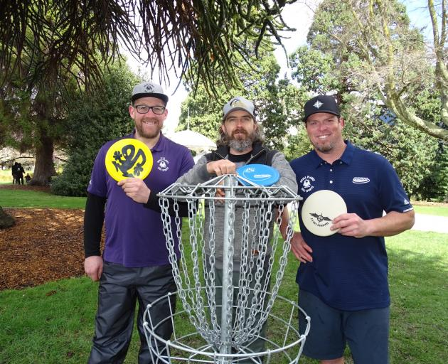 Enjoying the Queenstown Classic disc golf competition yesterday are the event's organisers (from...