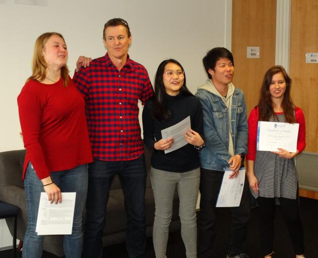 Singing Pokarekare Ana at their graduation ceremony with Language Schools New Zealand owner Guy...