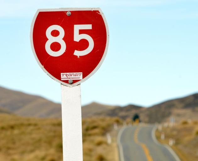 State Highway 85, the  Pigroot, winds through tussock-covered hills between Kyeburn and...