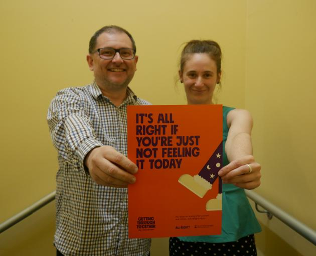 Volunteer South team member Rob Tigeir and manager Leisa de Klerk hold one of the posters...