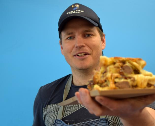 Hungry Hobos owner Romeo Dowling-Mitchell, of Mornington, and his Bat Out of Hell sandwich — a...